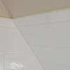 Tiling a sloped shower wall