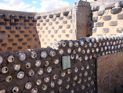 Earthship walls under construction (CC BY-SA 2.0) - by theregeneration