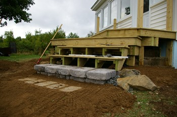 Faux stone step leadiing to deck