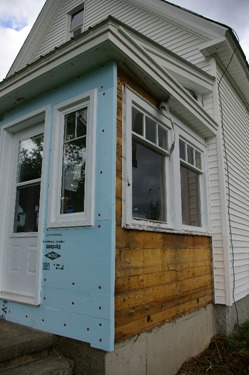 Front windows and door installed over rigid foam insulation
