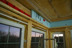 Installing rigid foam insulation at header