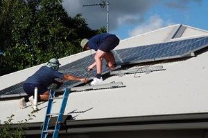 Men installing Solar Panels - (CC BY 2.0) by Allan Henderson