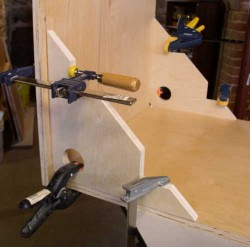 Right-angle jigs hold cabinet gable