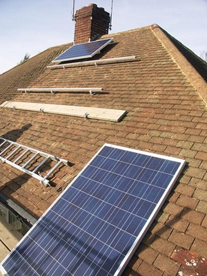 Solar panel installation - (CC BY 2.0) by jonsowman