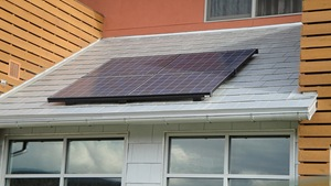 Solar panels on porch roof - (CC BY-SA 2.0) by Dave Dugdale