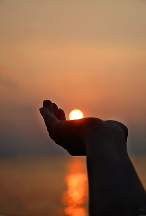 Sun in hand - (CC BY 2.0) by notsogoodphotography