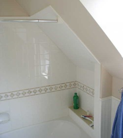 bath tub shelf under sloped ceiling