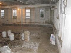 buckets of whitewash in barn