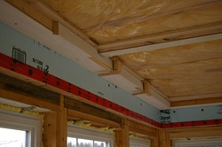 coffered ceiling masks rigid insulation at header