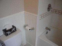 beadboard conceals plumbing access