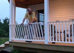 installing railing section on veranda