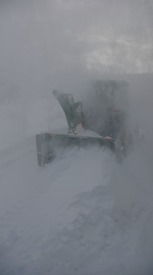 john-deere-tractor-in white-out-conditions-pm