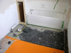 laying ditra over composite tile floor
