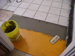 laying tile over ditra in bathroom