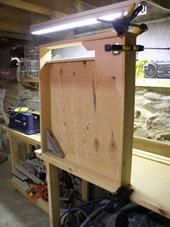 the box is made of cedar boards with quarter-inch plywood back