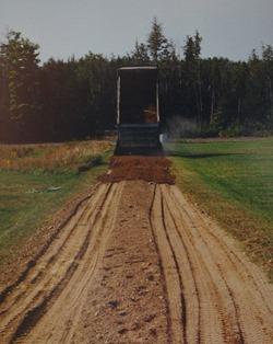 truck_spreading_layer_of_gravel